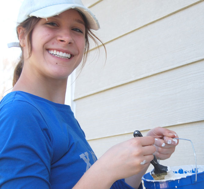 Volunteer painting trim